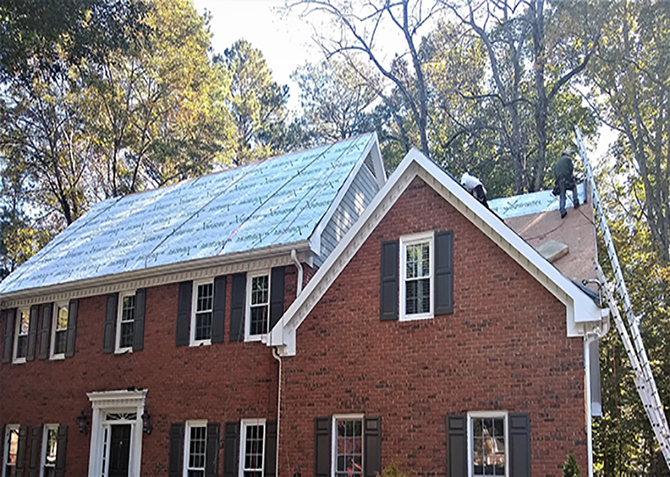 The roofing crew hard at work in Marietta